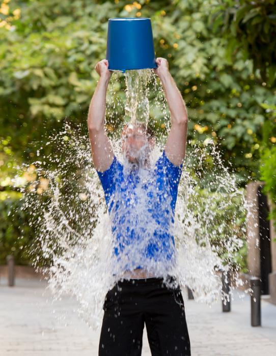[A man completing the ALS Ice Bucket Challenge]