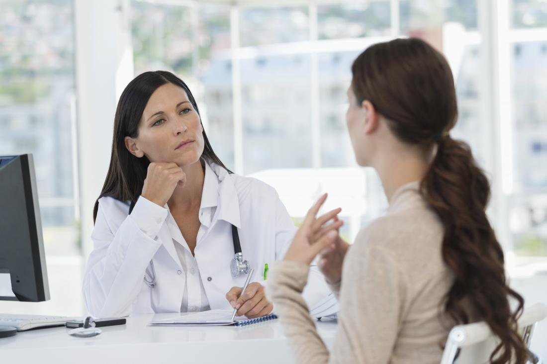 person talking to doctor