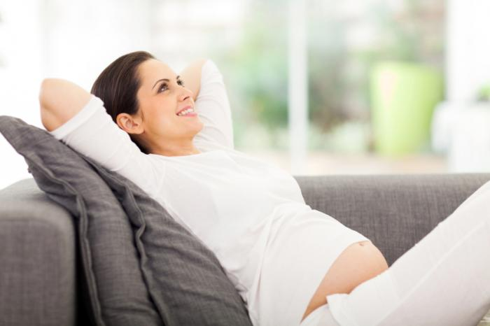 [Pregnant woman relaxing]