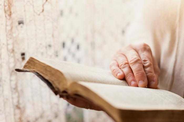 [An older person reading a book]