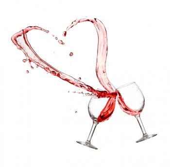 [Two glasses with red wine in the shape of a heart]
