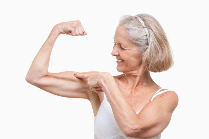 [Elderly woman showing off her muscles]