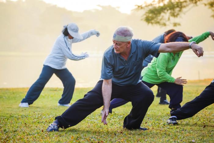 [Adults practicing Tai Chi]