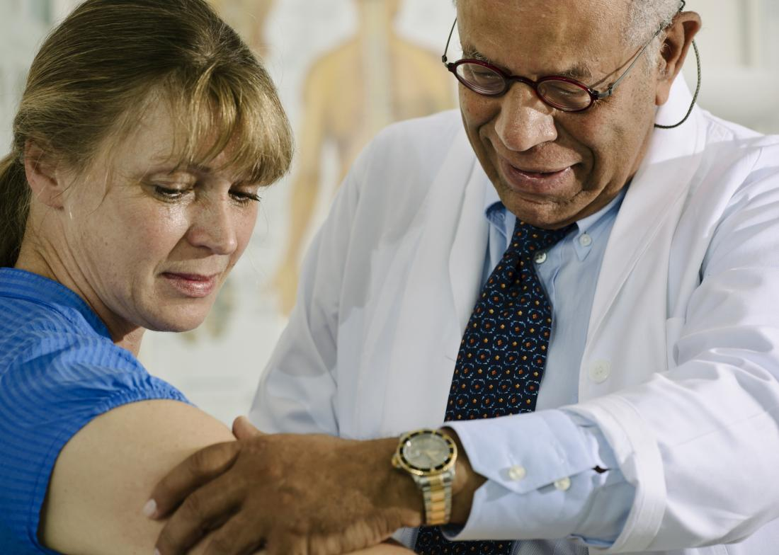 Doctor examines arm
