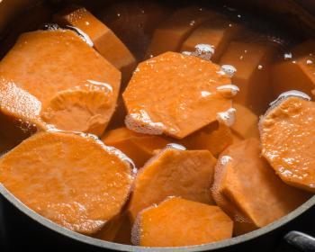 [Sweet potatoes in a pan of water]
