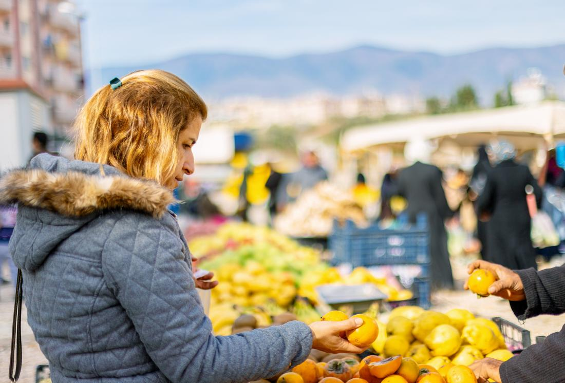 Woman buying healthful food for psoriasis