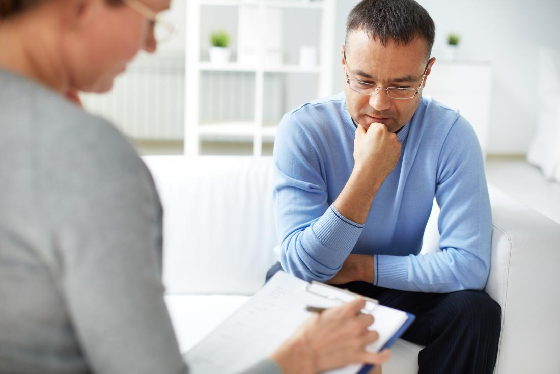 Man in therapy or counseling session with psychiatrist