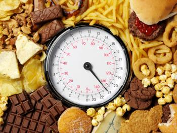 [Unhealthy foods and a set of scales]