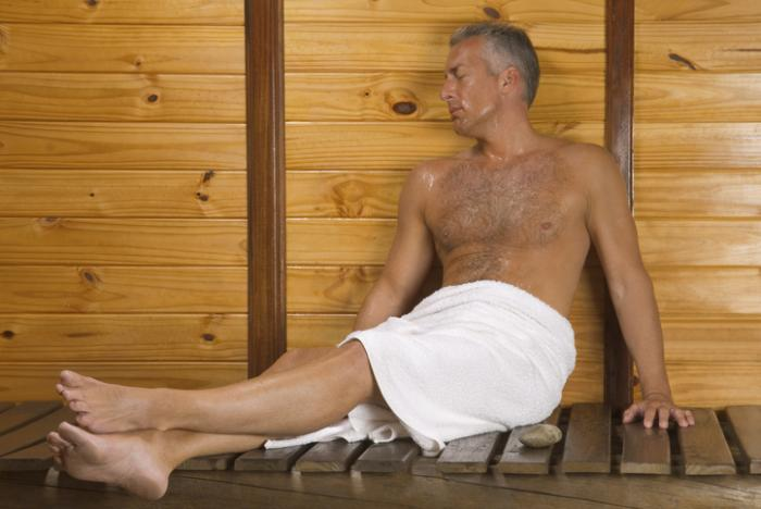 [A mature man in a sauna]