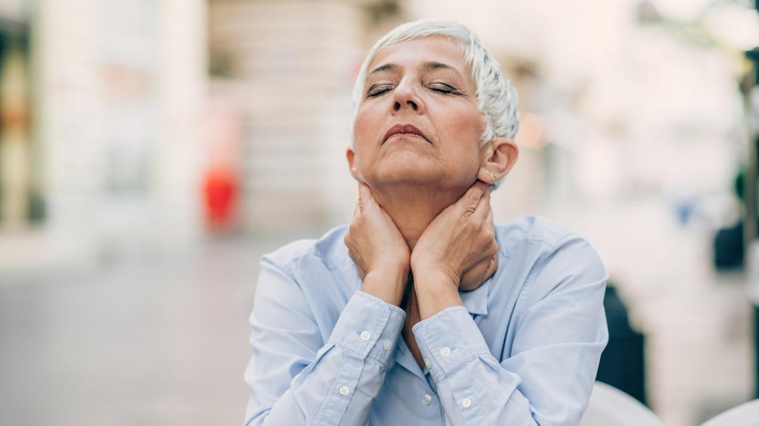 a women experiencing symptoms of the menopause