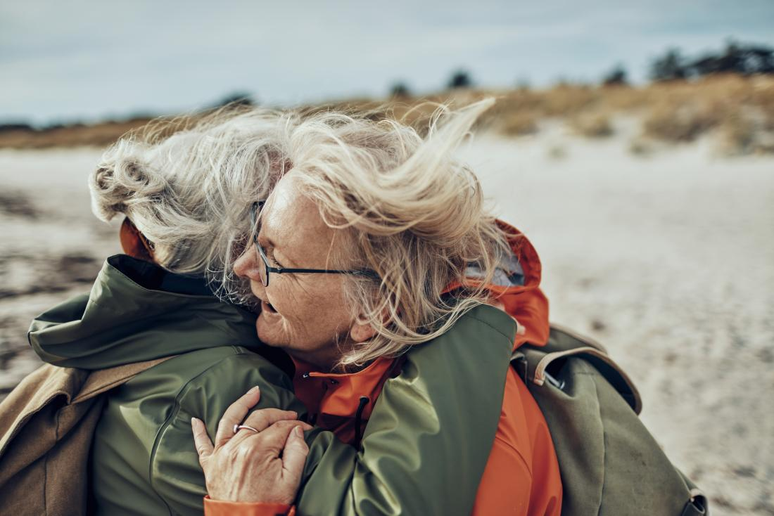 two older woman embrace before they learn the outlook for COPD.
