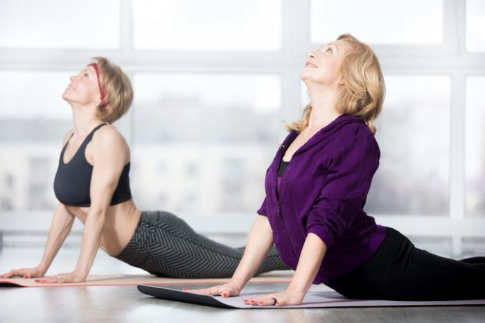 [ladies doing yoga]