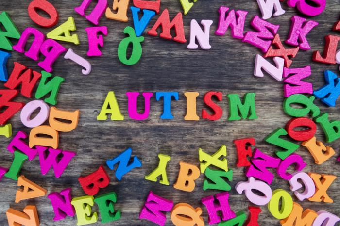 [Autism spelled out in colorful letters]