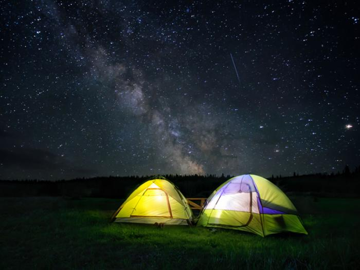 [Tents under the stars at night]