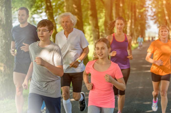 family jogging in park