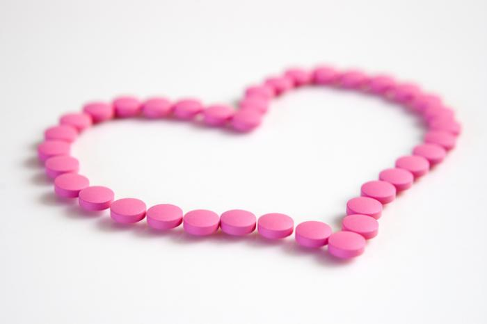 Pills arranged in the shape of a heart.