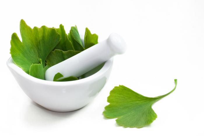 Ginkgo biloba leaf in a mortar with a pestle. Erectile dysfunction Impotence