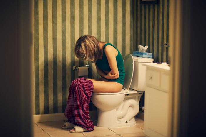 Lady with bladder infection on the toilet