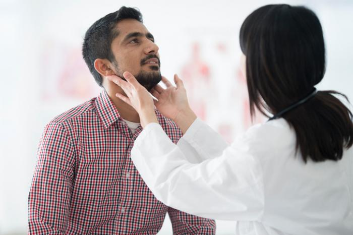 doctor checking a persons lymph nodes