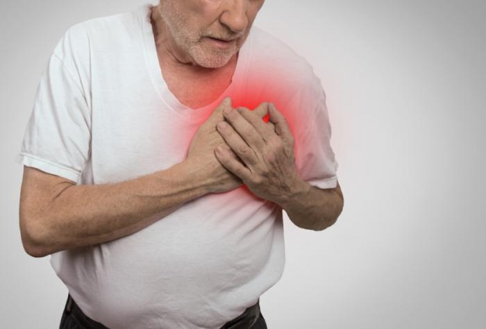 man holding painful left chest