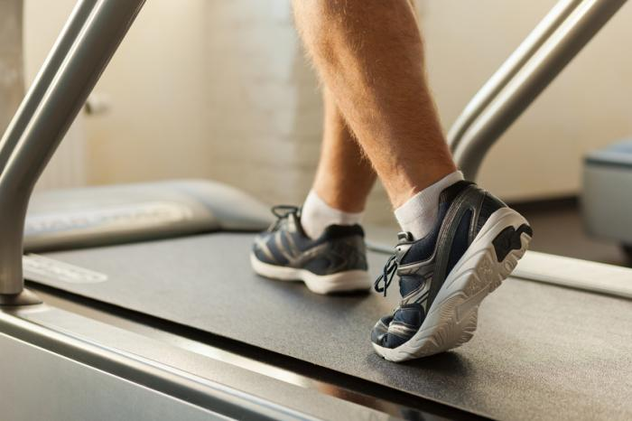 [A man on a treadmill]