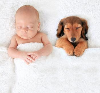 [A newborn baby and a puppy]
