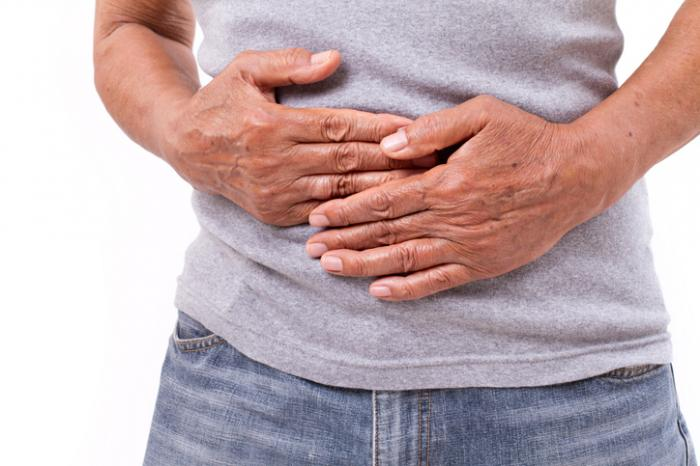 person clutching stomach