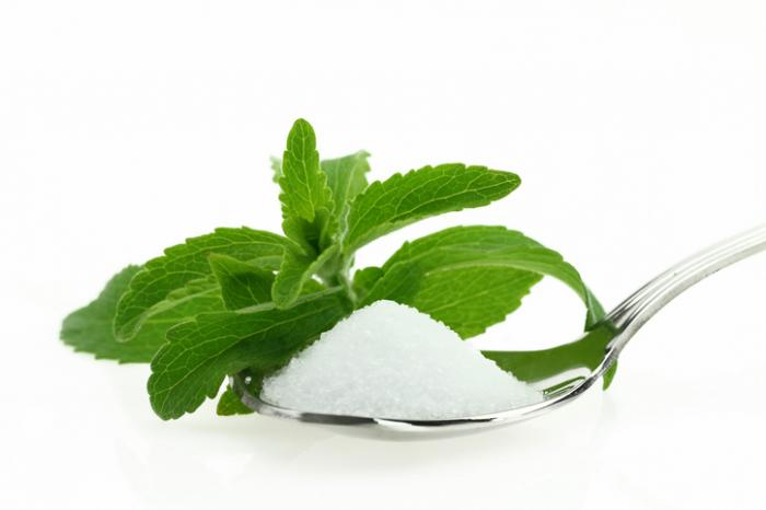 [Stevia leaf and a teaspoon of stevia]