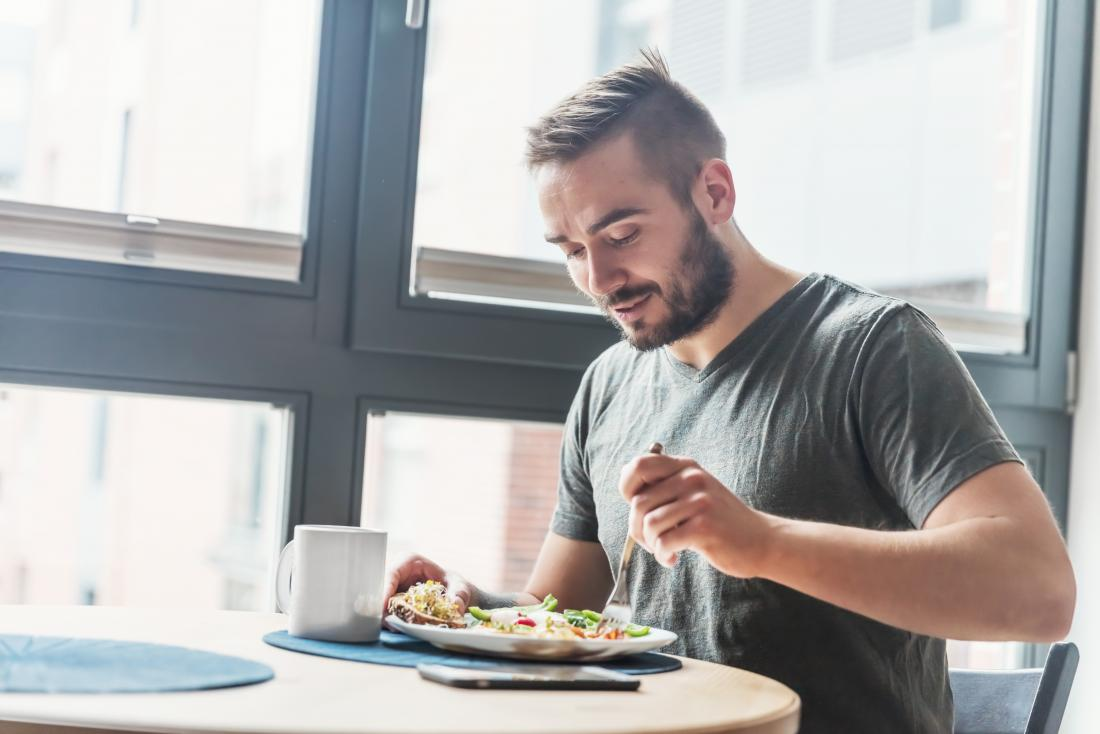 Man eating healthy food alone.
