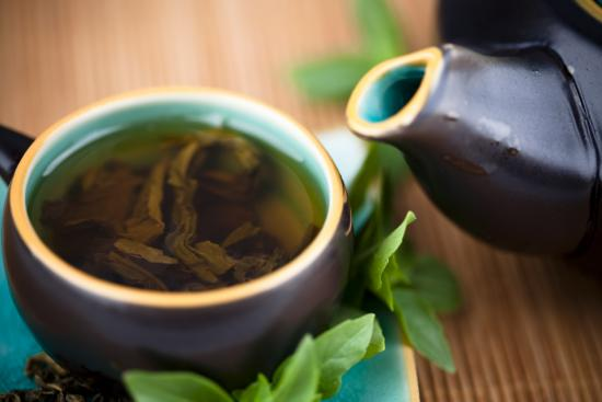 [cup and teapot of green tea]