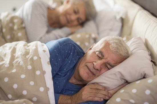 [Older adults sleeping in bed]