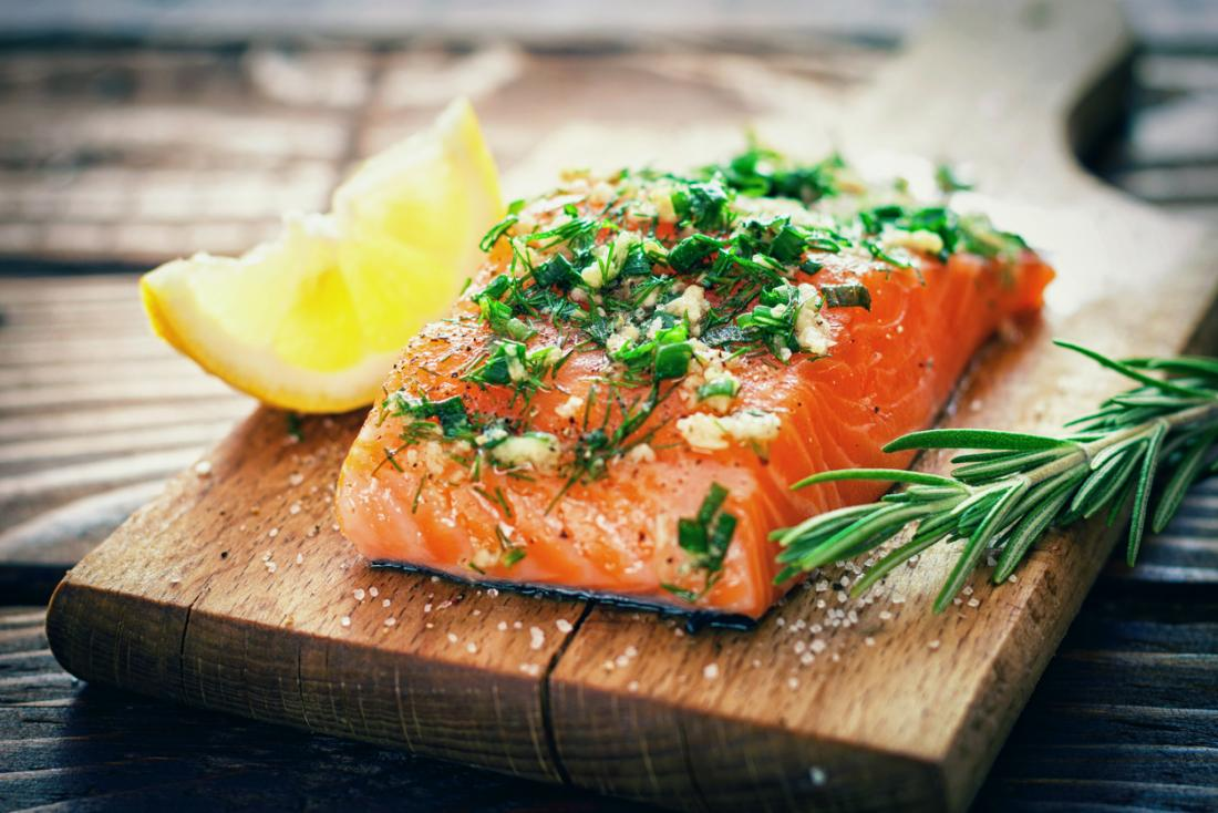 [salmon on a wooden board]