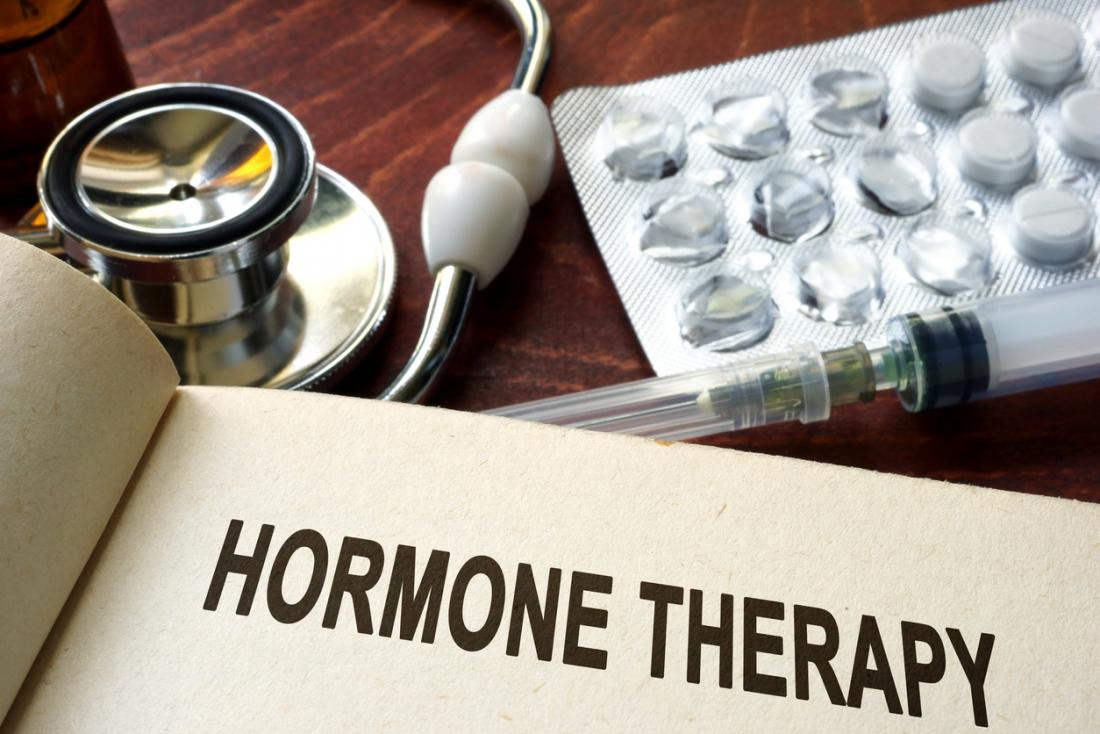 [hormone therapy written in book with hormones and stethoscope]
