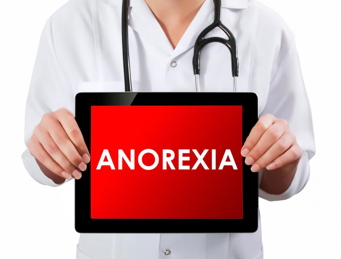 [doctor holding anorexia sign]