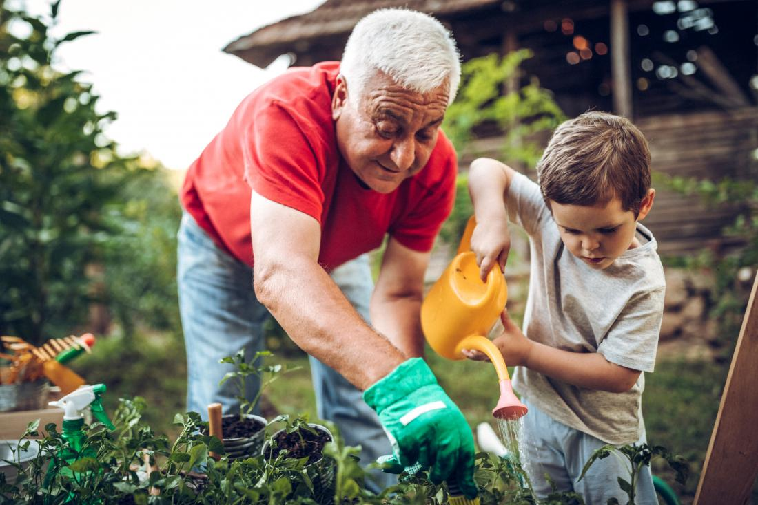 man with child in garden enjoying life