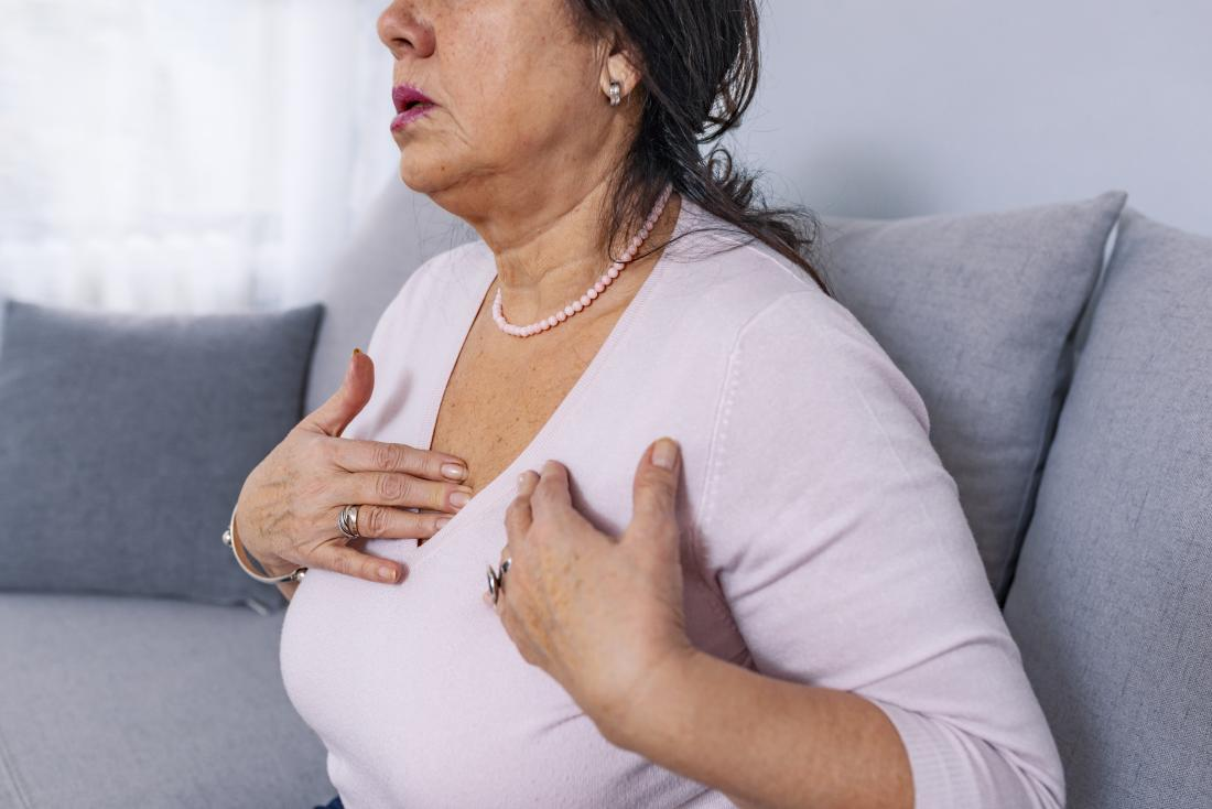 a woman experiencing chest pain from lung nodules