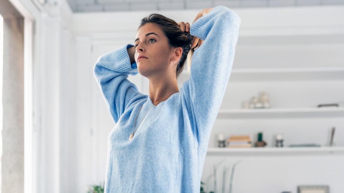 a woman looking pensive as she thinks about her vaginal odor