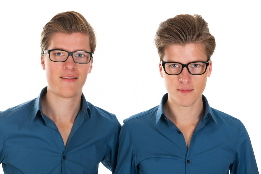 [Identical twins with glasses]