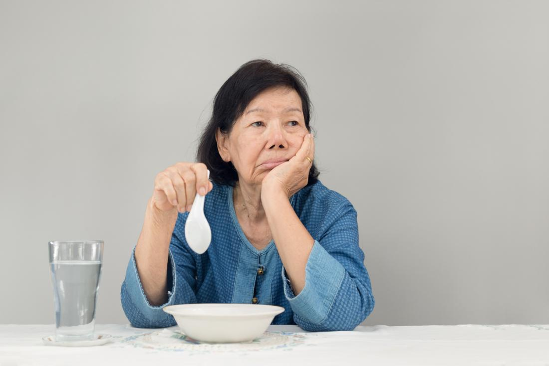 Older Japanese lady eating alone
