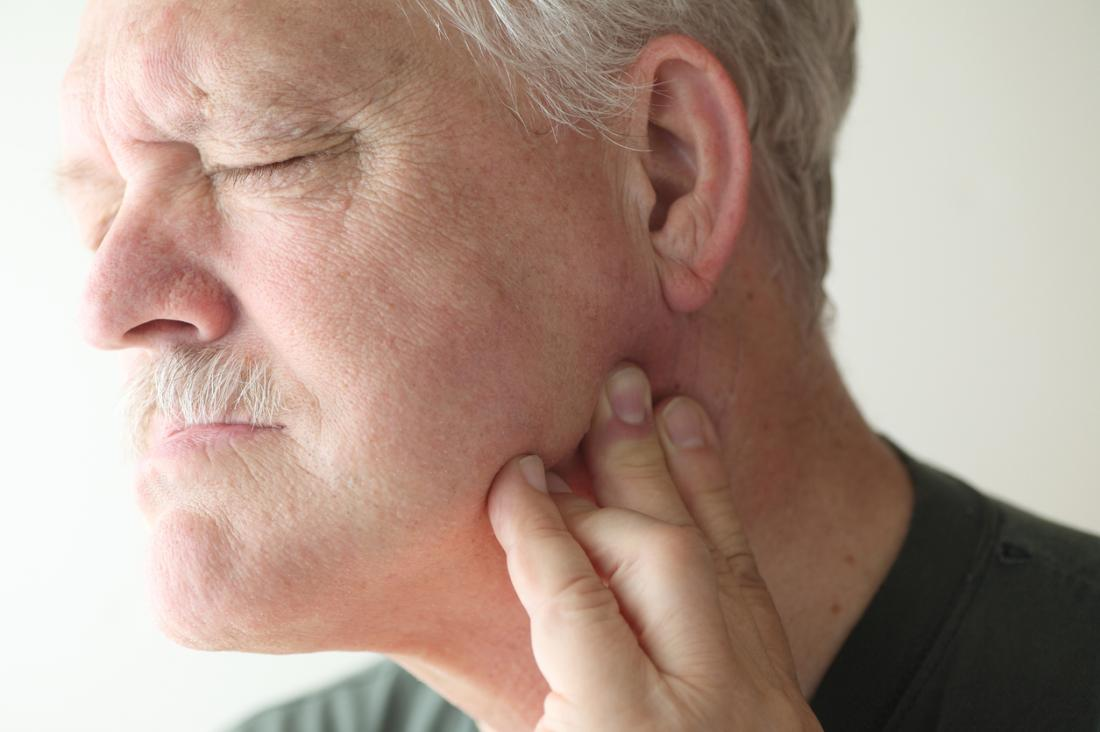 Man with painful temporomandibular joint