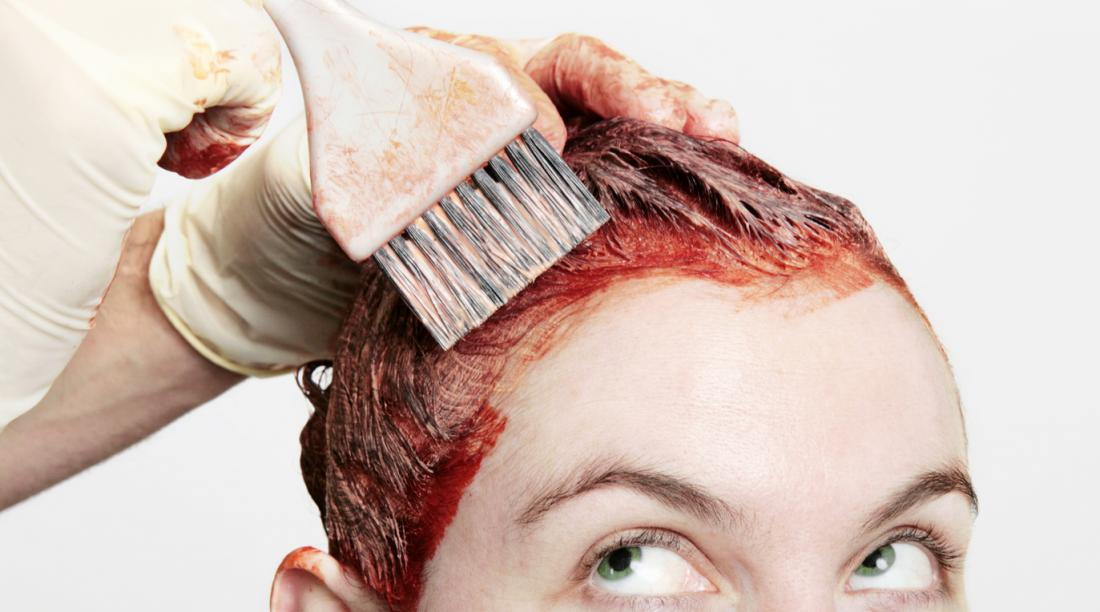 woman dying her hair red