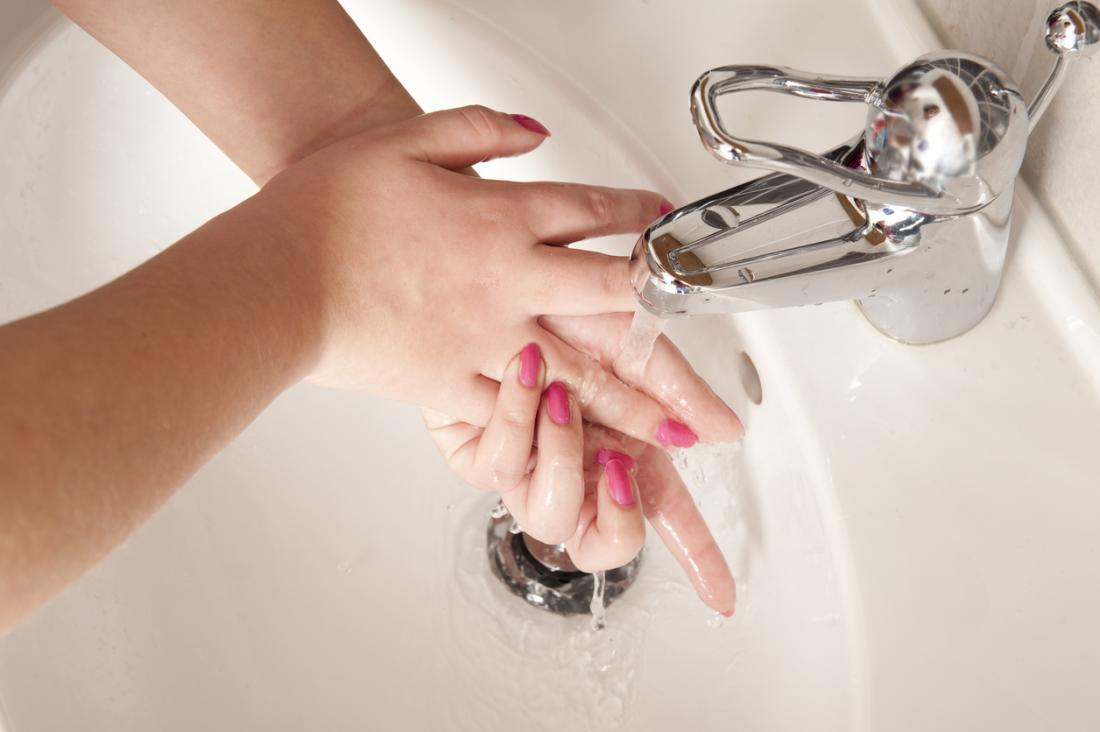 Woman washing hands OCD