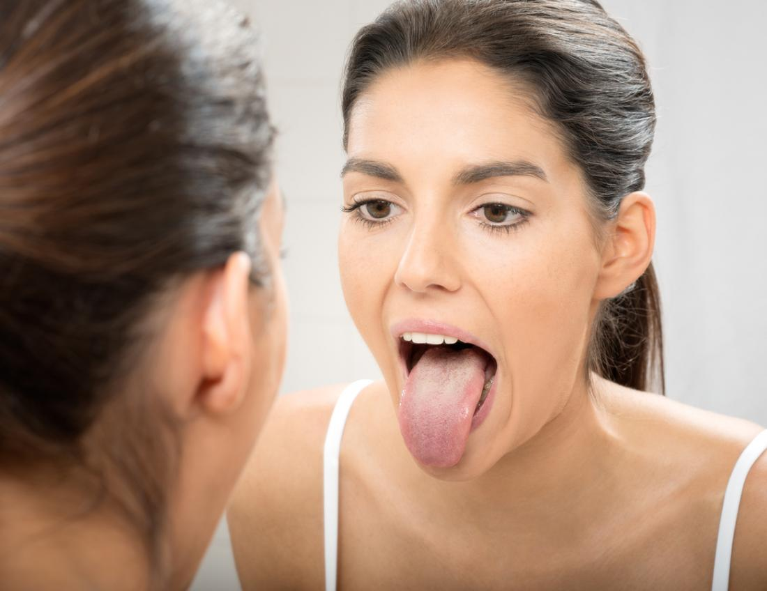 woman sticking her tongue out in the mirror
