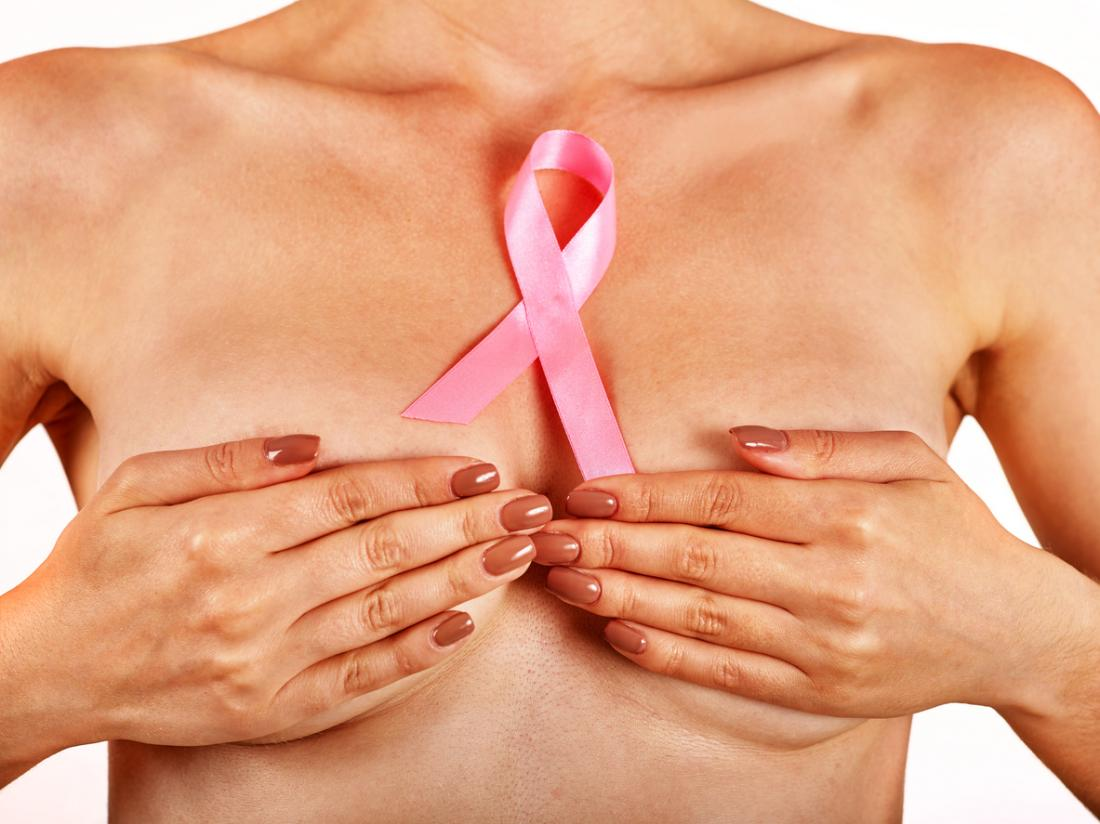 lady holding breasts with breast cancer ribbon