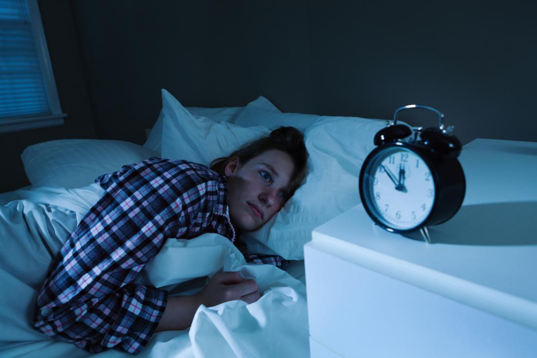 a woman unable to sleep