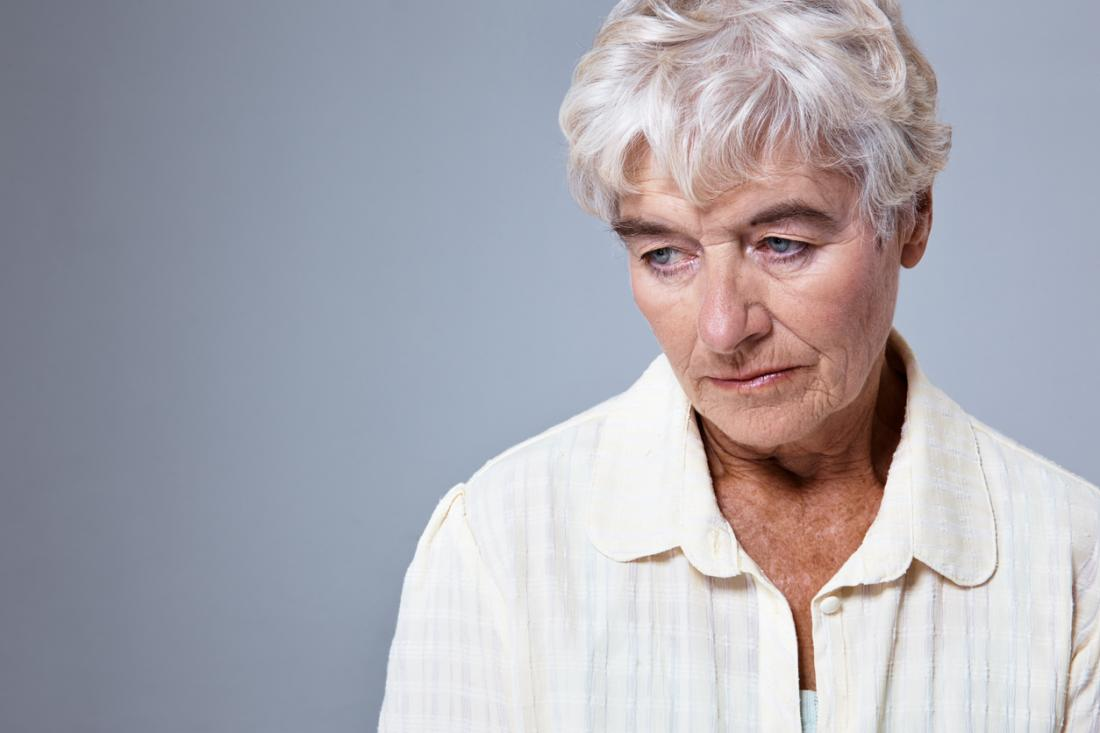 older woman looking sad