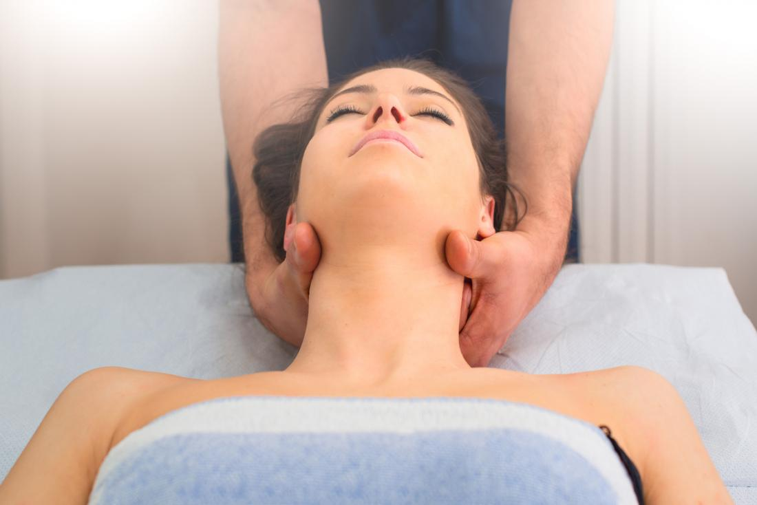Woman having head and neck massaged.