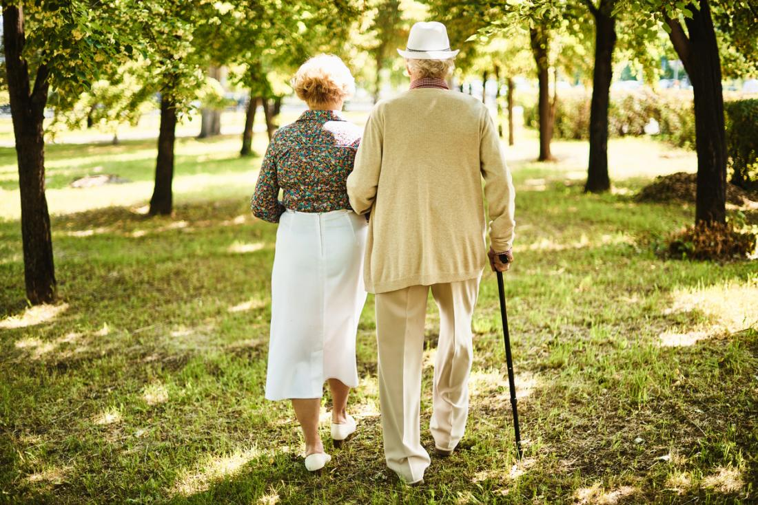 Old couple walking.