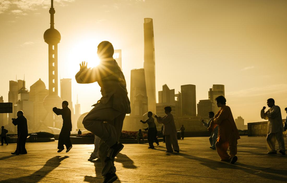 Older adults tai chi at sunset China