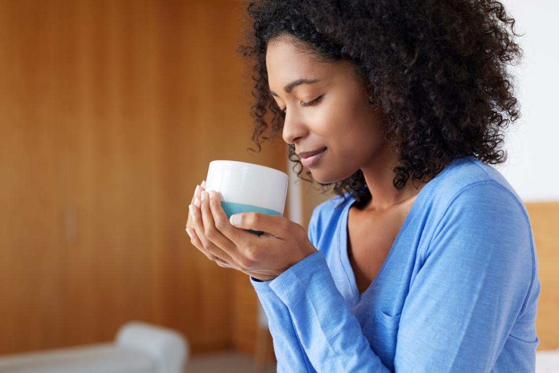 Woman with mug of coffee.